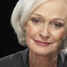 Senior woman with white hair.