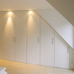 sloped ceiling wardrobe with lights. A perfect solution to storage problems
