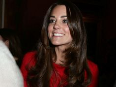 Kate Middleton repeats another dress, wearing her red Alexander McQueen dress for a reception at Buckingham Palace.