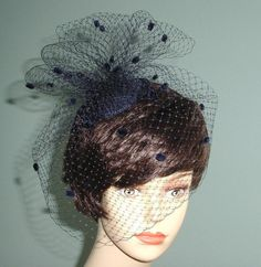 This little wedding hat starts with a round base of sinimay. Then I added a chenile dot French veiling cage blusher and loops of more French veiling. A sassy little addition for bridesmaid attire. A large alligator clip is used to attach to your hairdo. Bridesmaid Accessories, Bridal Accessories, Blue Bridal, Blue Wedding, Wedding Hats, Wedding Themes, Cocktail Hat, Blusher, Fascinator
