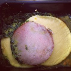 Diet-to-Go for breakfast. Canadian bacon. Egg patties and creamed spinach.
