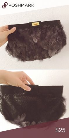 ASOS Feather Clutch Fantastic/new condition. Golden clasp shut. Clutch is black with grey feathers. Interior is black and perfectly clean. Will fit a wallet, iPhone 6 Plus, and some keys. Perfect size for any occasion! Can be dressed up or dressed down as well. ASOS Bags Clutches & Wristlets