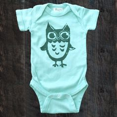 100% certified organic cotton, this onesie is super soft on baby's skin, hand dyed and hand screen printed with environmentally friendly, non-toxic dyes.
