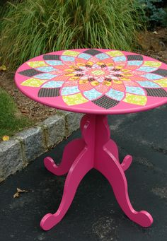 Adorable pink table with decoupage fabric flower mosaic. Not a full tutorial, but she says she used mod podge on an IKEA table.