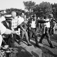 Dr. Martin Luther King Jr. ducks after being hit in the head by a rock during a housing discrimination protest in Chicago on Aug. 5, 1966. (Bettmann/Corbis/AP Images)