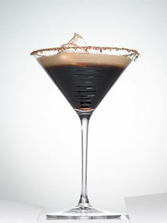 Espresso Martini  - Shot of espresso  - 1/2 oz. Three Olives Chocolate Vodka  - 1/2 oz. Godiva dark chocolate liqueur  - 1/4 oz. Amaretto  - 1/4 oz. Kahlúa  - Baileys to top off    Shake ingredients with ice. Rim the glass with shaved chocolate. Strain cocktail and top with Baileys, whipped cream, and cocoa.
