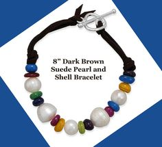 """Color galore in this cute pearl and shell suede toggle bracelet. 8"""" double strand brown suede toggle fashion bracelet with 11mm cultured freshwater pearls and 8mm dyed shell beads. The shell beads are blue, purple, green, yellow and pink. Just cute!"""