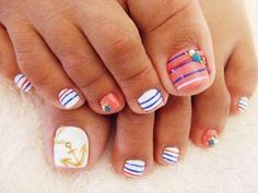 Nautical pedicure nail art - gold anchors, stripes, gems