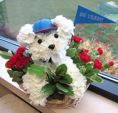 Dog gone cute flower arrangement created by The Flower Source www.flower-source.com/