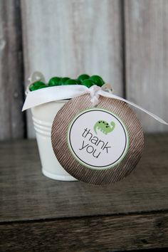 dinosaur favor tags - pails filled with dino eggs.