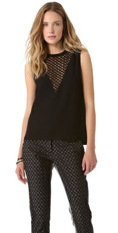 $350.00 FREE SHIPPING at shopbop.com. Crafted in a crisp, textured weave and detailed with sheer, checkered tulle insets, this A.L.C. tank cuts a chic, edgy profile. Hook-and-eye keyhole at back. Fabric: Textured weave / checkered tulle. 60% viscose/23% virgin wool/17% wool. Trim: 72% nylon/23% spandex. Dry clean. Made in the USA of fabric from Italy. MEASUREMENTS Length: 23in / 58.5cm, from shoulder - Black
