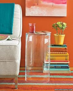 Quick Side Table | Florists rely on sturdy, high-volume vases to house and hydrate their stock, but with a simple flip, one of these hardworking holders (in 1/4-inch or thicker glass) can also do a stand-up job as a sleek side table. Leave one unadorned as a versatile complement to modern or traditional furniture, or place it over a valued object like a small sculpture for an instant display case