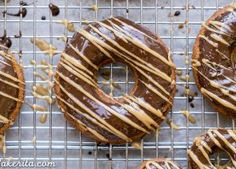 These Baked Peanut Butter Banana Donuts have a chocolate glaze & peanut butter drizzle! These healthier donuts are gluten-free, refined sugar-free + vegan.