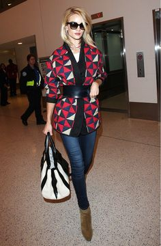 Rosie Huntington-Whiteley wears an Étoile Isabel Marant cotton coat, jeans, tan suede boots, and black and white bag