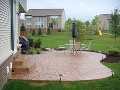 Like the shape of the patio-want an additional fire ring off of it