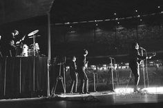 In this energetic and unique photo taken from Bob Bonis' unique position on the side of the stage, all four Beatles—Paul McCartney, George Harrison, Ringo Starr and John Lennon—jam on stage during their show at Municipal Stadium in Kansas City on September 17, 1964. That performance was their only unscheduled stop on the 1964 US tour. Local mogul Charles O. Finley persuaded the Beatles to play Kansas City for a record $150,000.