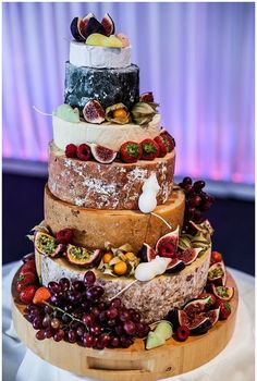 Eye catching naked wedding cake with fresh fruit • follow Maude and Hermione on Pinterest for more wedding inspirations