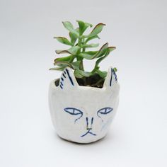 Ceramic cat planter. Made by Kaye Blegvad.