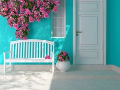 Entrance of a house. Front view of a wooden white door on a blue house with window. Beautiful roses and bench on the porch. Entrance of a house. Polyester Rugs, White Doors, House Entrance, Porch Swing, Front Porch, House Front, Elle Decor, Outdoor Furniture, Outdoor Decor
