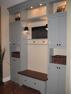 Great set up for mudroom. I would take the upper cabinets all the way to the top, though.
