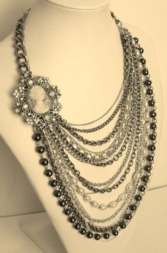 Love the simplicity of it, One cameo with chains and a minimal beads.  The grays make this necklace very elegant.