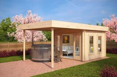"""The """"Lucas E"""" will make your summers in the garden so much more enjoyable. Two large windows enable you to enjoy the view of your garden. In addition to a spacious garden room, this modern garden summer house has a 9m2 canopy for grilling and dining outdoors without being afraid of sudden rain. This fantastic garden log cabin comes with our premium sliding doors, double glazed windows and 44 mm walls as standard!"""