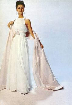 Model in white chiffon gown tied in bow with pink satin sash and full-length satin stole by Pierre Balmain, photo by Georges Saad, 1962