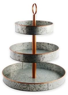 Set a trendy rustic scene for your casual entertaining with Galvanized Metal and Copper Serveware from Heritage Home. Each piece is crafted in galvanized metal for a vintage weathered look, with gleaming copper accents adding a touch of chic.