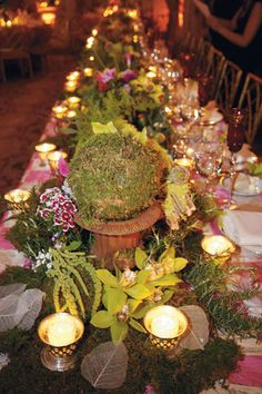 Give your tables a forest vibe by decorating with moss and leaves.