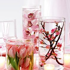 fake flowers emerged in water filled vases.