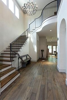 hammered metal stair rail and posts Foyer Staircase, Staircases, Staircase Ideas, Beautiful Interiors, Beautiful Homes, Metal Stair Railing, Prairie House, Large Ottoman, Bunker Hill