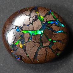 """fucktheflagandfuckyou: """" holographite: """" Boulder Opal """" deadass thought this was some sort of magical cosmic cookie and I'm really pissed it's a fucking rock """""""