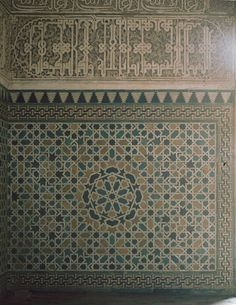 Image SPA 1319 featuring decorated area from the Alhambra, in Granada, Spain, showing Geometric PatternFloriated Arabesque and Calligraphy using ceramic tiles, mosaic or pottery and stucco or plasterwork.