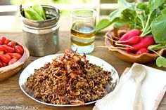 Lentil and bulgur pilaf (Mujaddra janoubieh) -- INGREDIENTS:  1 cup of brown lentils 4 large onions 3 cups of water 1 cup of coarse brown bulgur salt, to taste 1 tsp of cumin if desired olive oil, as needed