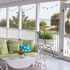 sigh.  i heart big porches w/ benches covered in happy fabric