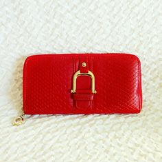 29✂NWOT Red Lizard Zip Around WalletHP PRICE IS FIRM (Seeon TITLE) Make me an offer, it's YOURS! ➖➖➖  ✨NWOT✨  ⏩Precisely crafted in delicately textured yet remarkably durable faux leather, this slender, minimalist design fits neatly into your bag ⏩Featuring deep, luxuriously rich dark red color & gold tone hardware, this wallet is simply stunning!  ⏩Interior has 8 card slots, 2 full length bill pockets, 1 central zipped pocket, 3 full length open compartments ⏩Perfect for your everyday…