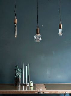 Make dark, winter mornings feel cosier indoors. Hanging lighting low over the dining table makes eating there feel more intimate. And when the table isn't in use, you can always add a hook on the ceiling to pull the lights back and out of the way. More lighting tips at IKEA.com #IKEAIDEAS