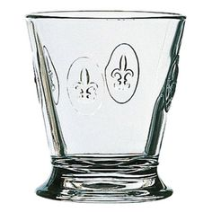 Water glass with an embossed fleur-de-lis motif. Made in France.    Product: Set of 6 water glassesConstruction Material...