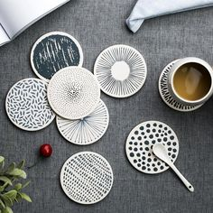 Monochrome Circular Coasters Uniquely designed, these water absorbant and heat resistant cork coasters will be an aesthetic addition to your dinner table while keeping water rings at bay.