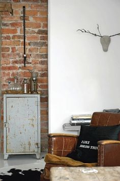 exposed brick wall juxtaposed with white plaster wall and vintage furniture