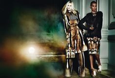 Glam Stars – Liu Wen, Liya Kebede and Iselin Steiro are the stars of Roberto Cavalli's fall 2013 campaign shot on location at a downtown Paris building. The images were photographed by Mario Testino and are inspired by the scene after a societal party. Styled by Marie Chaix, the women charm in floral prints, animal patterns and luxe furs. Accessories focus on the Hera bag and jewelry fashioned after moths, snakes and fruit.