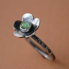 Sterling Silver and Peridot Flower Ring  Sweet and petite. A little spring blossom to adorn you. Wear alone or mix with your favorite stacking rings.