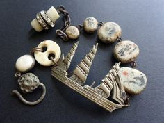 Off to Sea. Rustic assemblage bracelet with ship, Chinese calligraphy art beads.