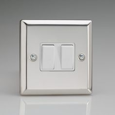 Mirror Chrome 2 gang Light Switch with White inserts 1 or 2 way switching Rated at 10amp Suitable for switching either mains or low voltage lighting Bevelled Edge faceplate Dimensions 91x91x25mm BS EN 60669-1 – BRITISH MADE