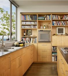 I love how the shelving continues along the whole wall into other rooms (click link to see)
