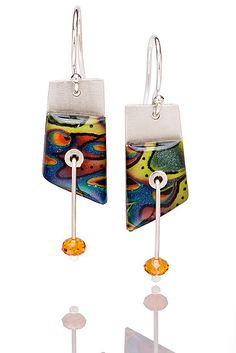 """""""Peggy in Graffiti""""  Silver & Polymer Clay Earrings    Created by Sue Savage  Colorful, whimsical one-of-a-kind art to wear influenced by the 17th-century Japanese technique, Mokume-gane. Savage starts with hand mixed colors to build the final palette then adds in detail with pen and ink. Always a bit funky sparked by the serendipitous results of the process."""