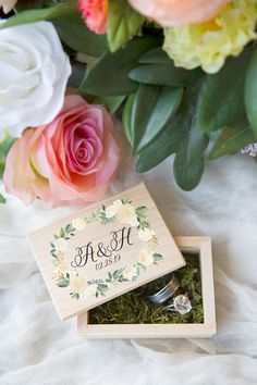 This wedding ring box is personalized wooden box filled with moss and features a floral print in a trending romantic style, perfect for holding the rings and as a beautiful keepsake! This little box is perfect for storing jewelry after the wedding day as well as so many other items!