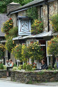 Enjoying a drink outside the Tanronnen Inn in Beddgelert, Wales (by alanfrombangor).