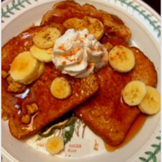French toast!  2/3 cup organic egg whites. 1/8 cup of almond milk. 1/8 tsp cinnamon. Allspice to taste. Tsp of local honey, or more to preferred sweetness. 1/4 tsp of vanilla extract. 1/2 of sliced banana. Warm Syrup. Sprinkled powdered sugar. Reddi whip. Cinnamon sprinkled on top. Granola of any kind <3 yum
