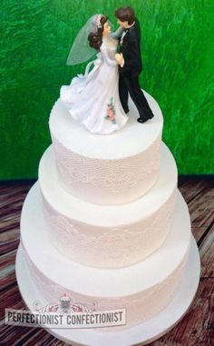 "White Lace Wedding Cake.  Ordered by Martina, for her sister Michelle, this is a 10"" and 7"" Ginger, Date and Lemon cake topped with a 4"" fruit cake tier. Love the white cake lace on this as have a thing for all white cakes.  Martina supplied the topper."